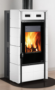 NORDICA-EXTRAFLAME FUTURA 10  Kw Revestimiento exterior de mayólica  Wood stove with the possibility of automatic loading of the briquettes  Cajón de cenizas extraíble Colores: blanca infinity o negro brillante.